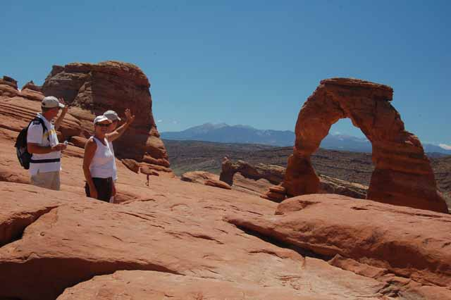 waving good-bye to Delicate Arch