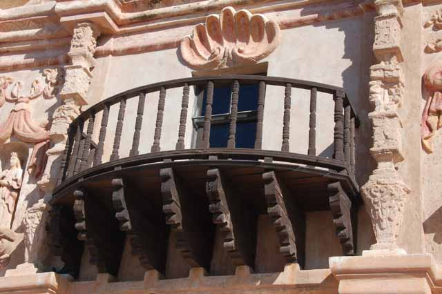 a balcony on the facade of Mission San Xavier