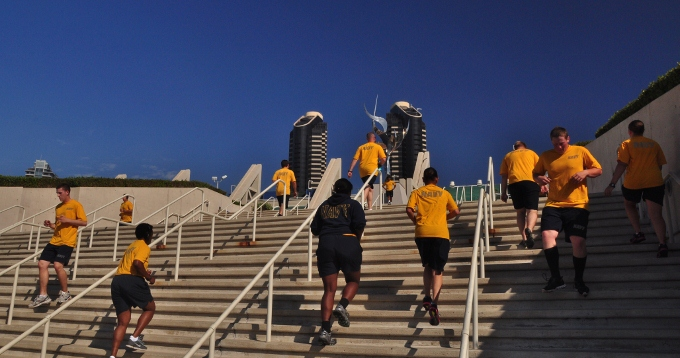 Navy recruits take part of the PT on the steps of the Convention Center