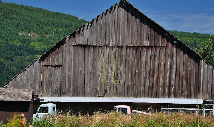 barn with trucks in front