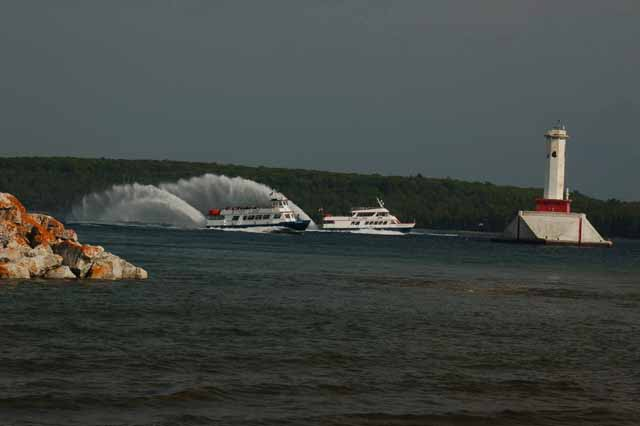 hydro-jets cruise past the Straits' lighthouses