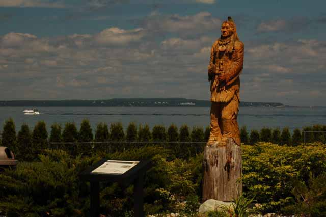 Mackinac Island in the background, Chief Wawatam statue in foreground