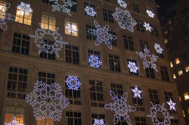 lighted snowflakes on side of building