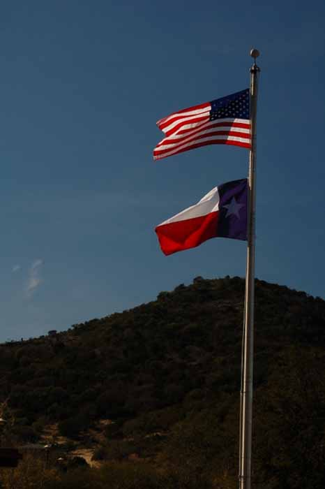 the Lone Star flag and American flag